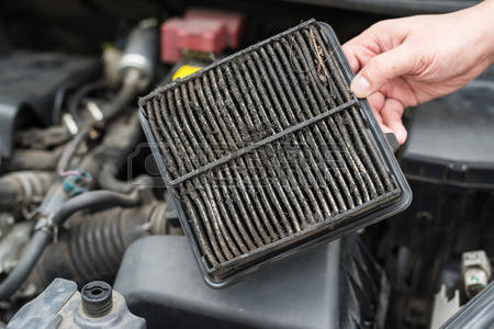 71379860-technician-holding-dirty-air-filter-for-car